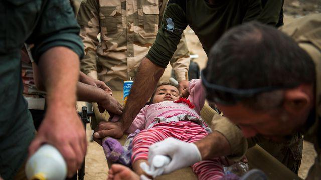 Mossoul: des enfants blessés et traumatisés