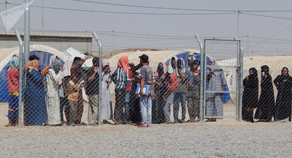 Iraq: Detaining thousands of women and children in camps for no crime illegal